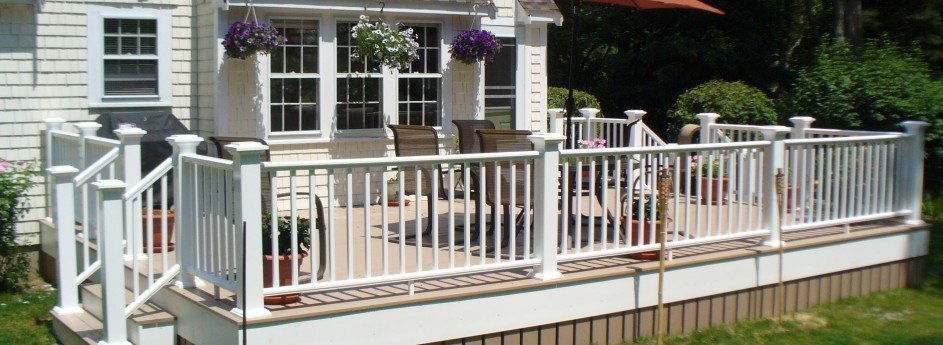 Beatiful outdoor deck in the sunshine with stairs and open railings
