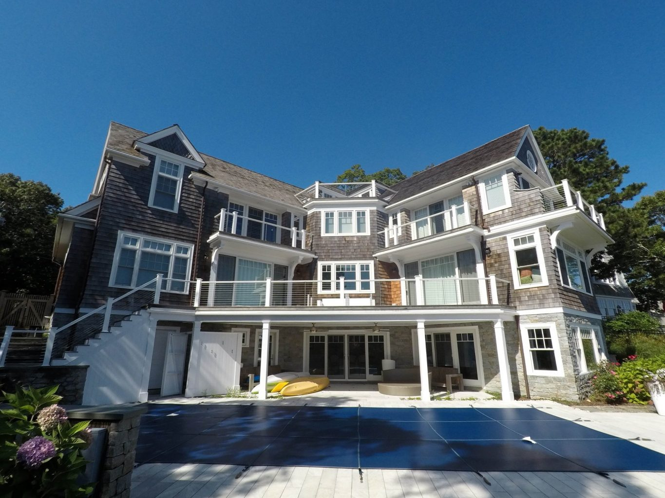 Large three level custom Cape Cod home with outdoor pool patio