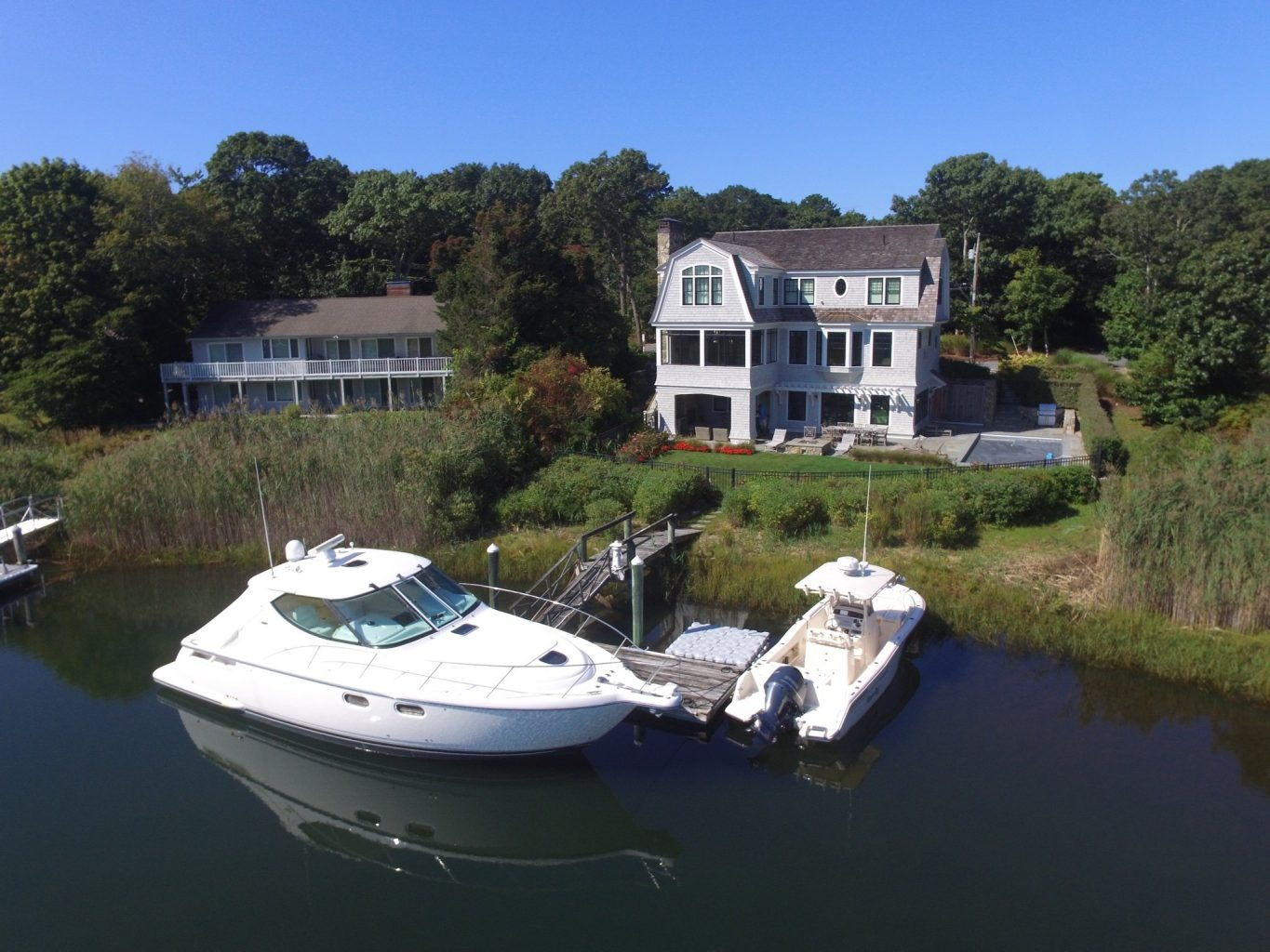 A beautiful three story waterfront home with dock and two boats