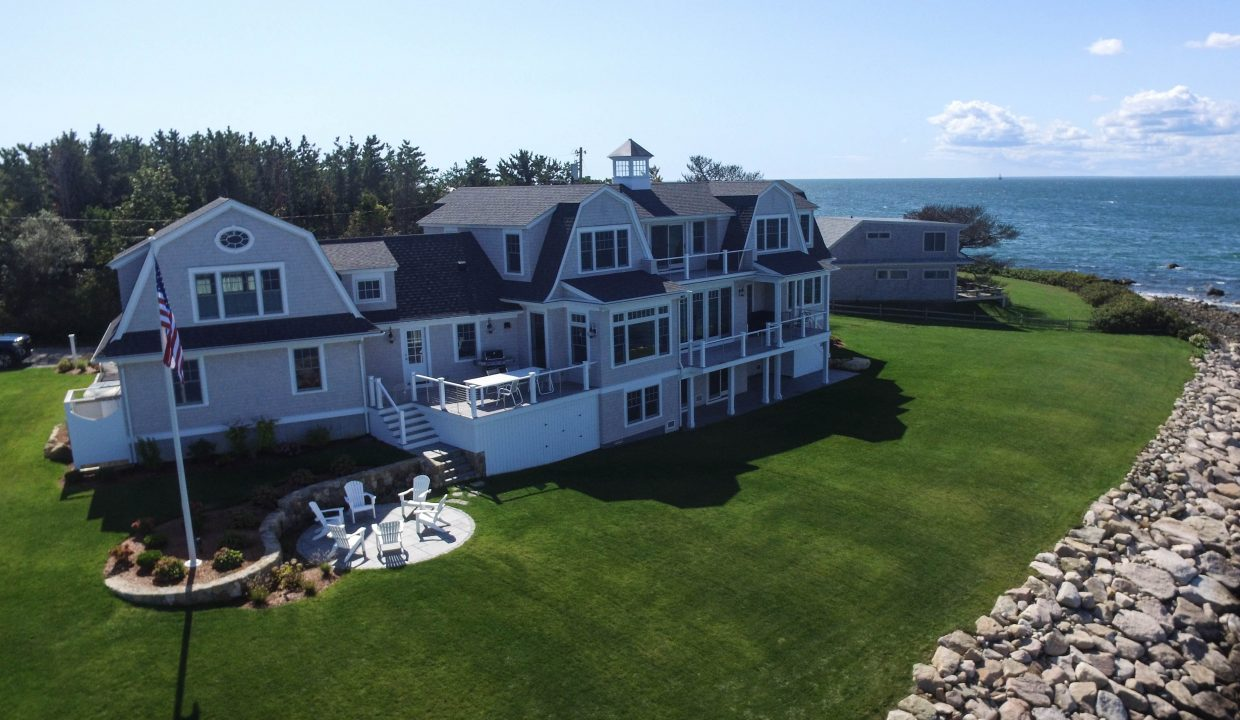 Very large oceanview home with a deck and a patio