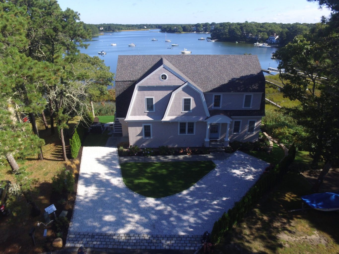 Arial view of a large home with a lake in the background